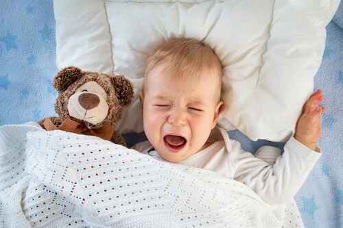 Photo of baby crying and in need of a sleep consultant's help.